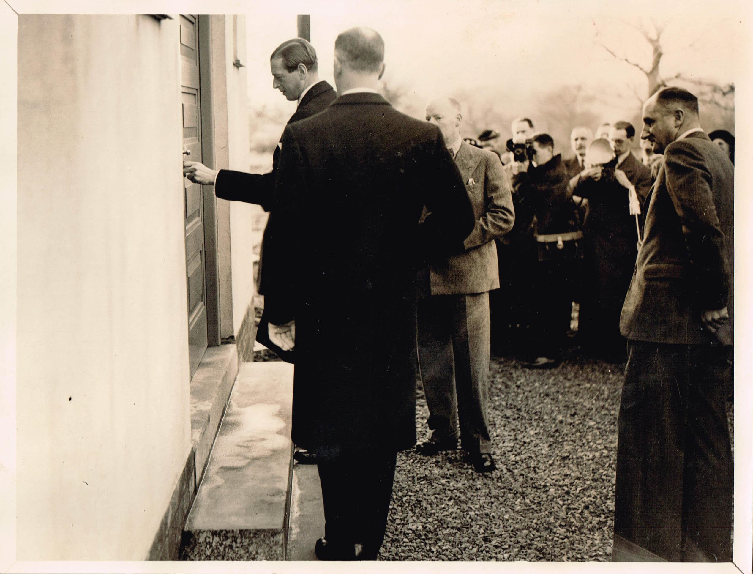 1.	His Royal Highness opening the door to the newly built Fillongley Village Hall on 14th December 1938