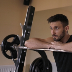 Image of a man doing weights at home links through to gym and fitness at home page