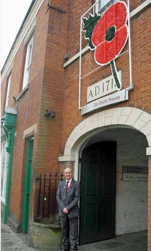 Councillor Andy Jenns with giant poppy